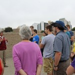 Learning the story of the Huaca Pucllana from a tour guide.