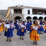 A comparsa, a group of singing dancers accompanied by musicians, moves  along the Plaza de Armas in Ayacucho for the carnival celebration. Some groups have as many as 200 members.