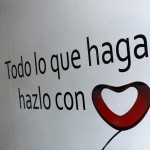 "A slogan at Radio Corazon (Heart) reads, ""Everything you do, do it with heart."""