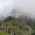 Clouds and mist shroud Machu Picchu.