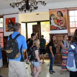 Students tour the gallery of Victor Delfin.