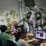 Announcers talk to a guest at Radio Felicidad (Happiness), which features adult contemporary music and positive messages.
