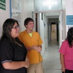 Caleb jokes with nurses Zaida and Adela.