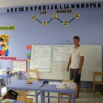Derek teaches the first-graders English in this classroom. No students this day, because the entire village was involved in a community meeting.