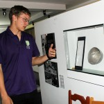 Thomas shows a metal bowl  donated to the Memory Museum by a person who used it while in a military prison.