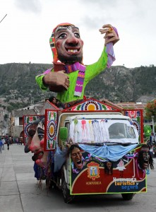 The Ño Carnavalon, a large effigy said to represent the spirit of the carnival, is driven through the Plaza de Armas.