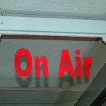 The flashing sign indicates that radio announcers are on the air.