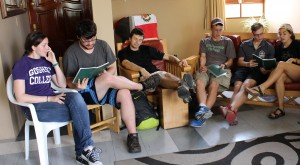 April, Jonathan, Neal, Thomas, Jackson, Gretchen and other students sing hymns at Casa Goshen.
