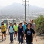 Jake and other students walk toward the biohuerto, or urban community garden, in Villa María del Triunfo.