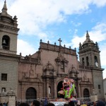 The Ño Carnavalon, a large effigy, is driven past the Ayacucho cathedral.