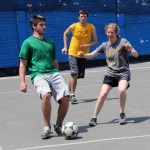 Caleb and Natalie seek control of the ball.