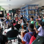 Elementary school students take music lessons in the library.