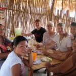Derek and Dean enjoy a dinner of chicken, rice and yucca with SST Co-Director Judy Weaver and family members.
