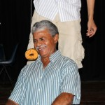 Juan Calderon, Maria's host father, seems wary of the doughnut-eating contest.