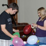 Jake and Aimee prepare decorations.
