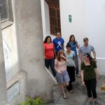 Students hurry to a second-floor meeting room at Buen Pastor church to learn their service assignments.
