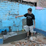 Jake shows an area where he helped to remove an old outdoor sink.
