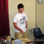 Caleb cuts his birthday cake.