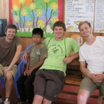 The Goshen guys hang out with one of the kids who has finished his chores.