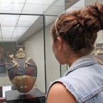 Malaina examines a unique Chancay culture sculpture in the museum.