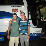 Neal and Jackson in front of the bus that will take them to their service assignment.