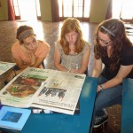 Gretchen, Natalie and April scan a Peruvian newspaper for current events they can discuss with the class.