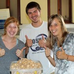 "Natalie, Caleb and Gina celebrate after making ""puppy chow"" for the farewell celebration."