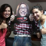 Maria and Gretchen have some fun with a promotional sign for Studio 92, one of RPP's seven radio stations.