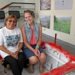 Malaina inside a boat on display at the museum with her supervisor, Rosa Huarca Equizabal, the municipality's director of educational programs.