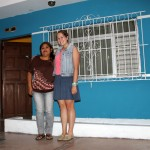 Malaina outside her Chancay home with her host mother, Kelly Hipolita Delgado.