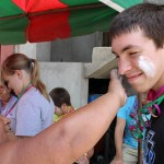 Alicia Taipe Tello puts talcum powder – a Peruvian lenten tradition – on Jake's face.