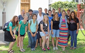 Students pause for a photo in the sunny courtyard of Victor's Delfin's home and studio.