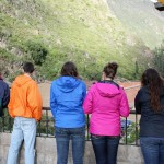 Students gaze out at Ollantaytambo.