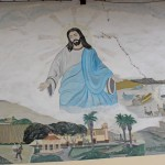 A mural beside the main Catholic church depicts Jesus watching over Chancay.