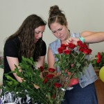 April and Malaina prepare flowers.