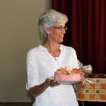 "Peru SST Co-Director Judy Weaver holds her birthday ""cake"" – actually a potato dish."