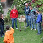 Students play a coin toss game at the hotel in Ollantaytambo.