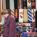 Jackson examines beautiful products at a textile store.