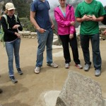 Natalie, Dean, Malaina and Caleb study a stone used as an effective compass by the Inca.