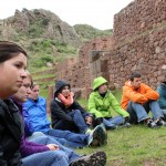 The students listens as he explains the blessing in Quechua.