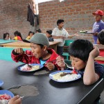 Children enjoy their lunch.