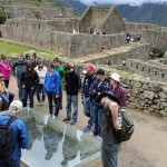 Oswaldo Palomino discusses Inca building techniques with students.