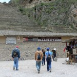 Students stride toward the military fortress of Ollantaytambo.