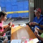 Jackson, Neal, Thomas and Caleb enjoy a card game on the train.