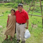 Service Coordinator Wilfredo Villavicencio with one of the Ashaninka children. She is wearing the traditional Cushma tunic.