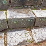 Inca stones, which still have ancient markings, were used to construct colonial buildings at Chinchero.