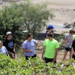 Aimee, Jake, Maria, Caleb and other students prepare to work in the community garden.