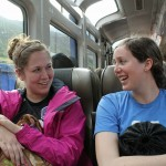 Malaina and April share a laugh on the train.