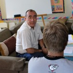 Moises Arce conducts an oral Spanish language evaluation with Derek.