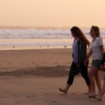 Maria, Gina and Malaina stroll on the beach at sunset.